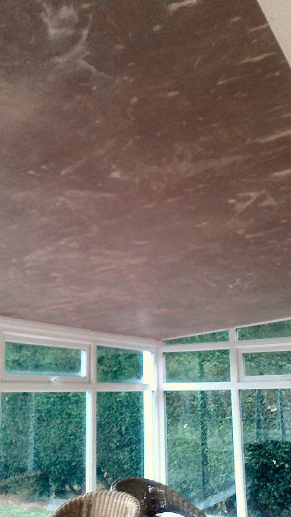 conservatory roof insulation system being plastered