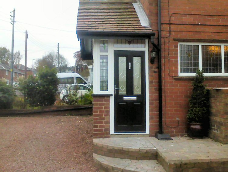 kommerling porch with a black Solidor composite door Gateshead